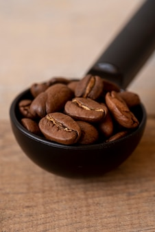 Close-up spoon with roasted coffee beans