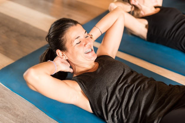 Close up of sportswoman doing abs exercise in gym. concept of gym.