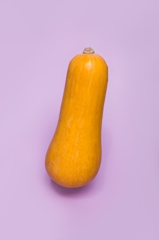 Close-up of a squash on purple surface
