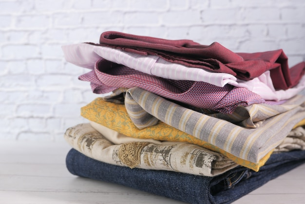 Close up of stack of cloths on table.
