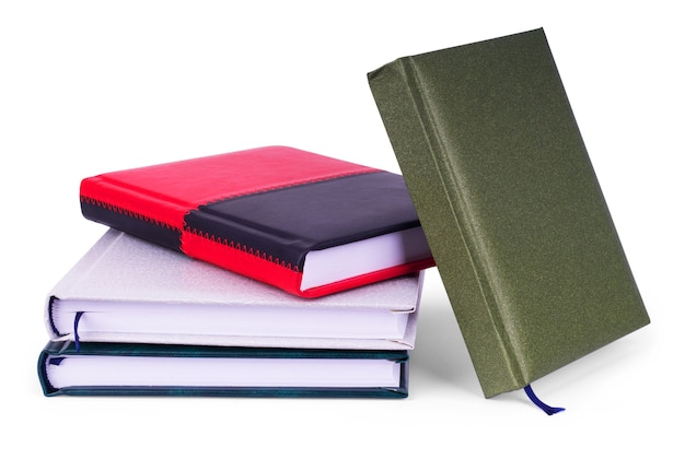 Close up of stack of colorful books and notebook on white background, with clipping path included