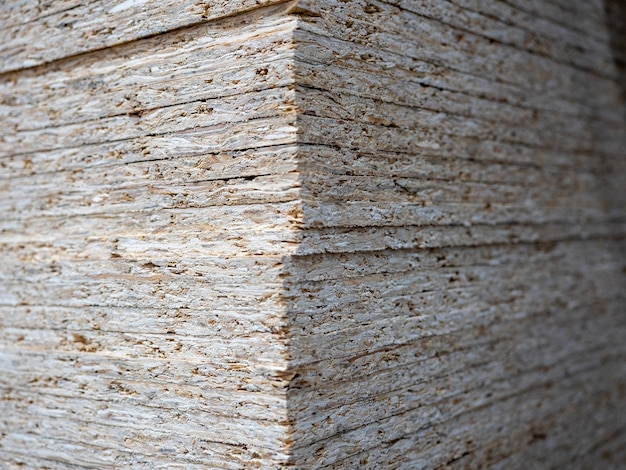 Close-up of a stack of osb sheets. lumber, construction, selective focus