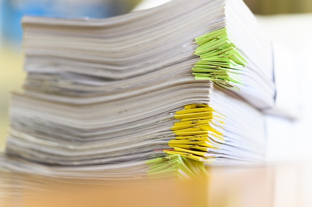 Close up of stacked documents at office desk