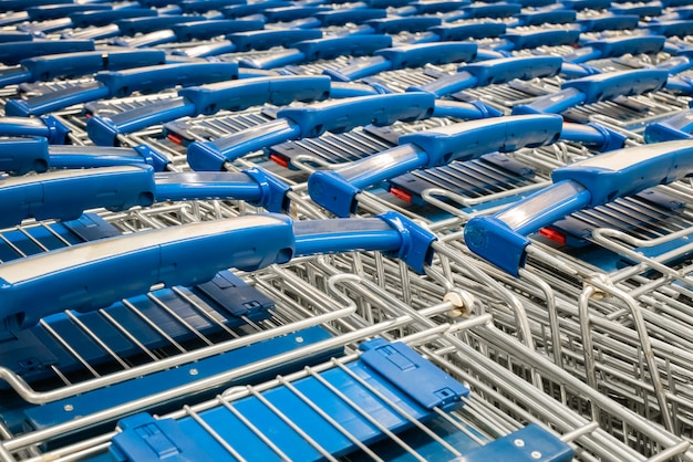 Close-up stacked shopping cart in department store.