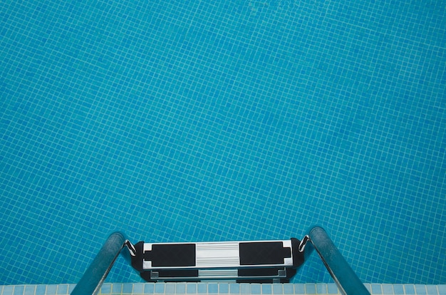 Close up of staircase and swimming pool. vacation and relax background.