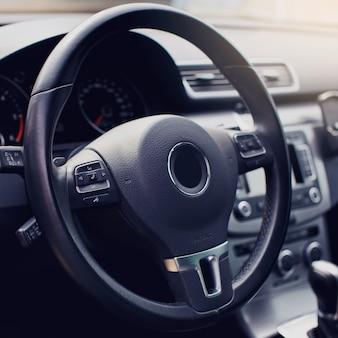 Close up steering wheel interior of modern premium car