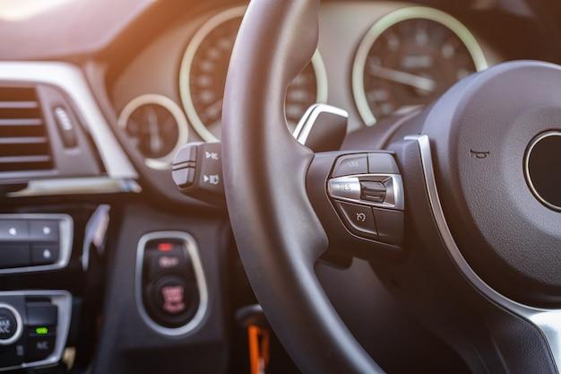 Close up of steering wheel, modern car interior details