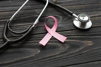 Close-up stethoscope and pink ribbon