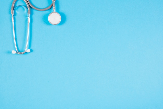 Close-up of stethoscope on blank blue background