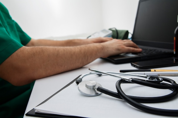 Close-up stethoscope on the doctor's desktop. the concept of a doctor in the workplace, online consultation
