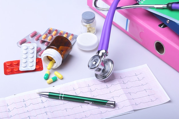 Close-up stethoscope lying on rx prescription with assorted pills. healthy life or insurance concept.