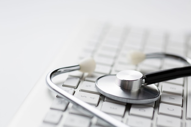 Close-up of stethoscope on wireless keyboard