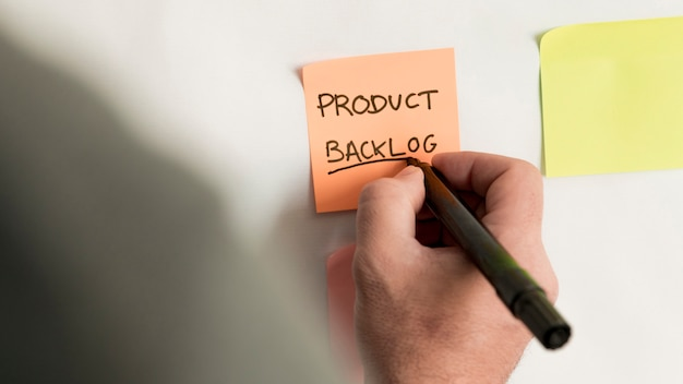 Close-up sticky note with product backlog
