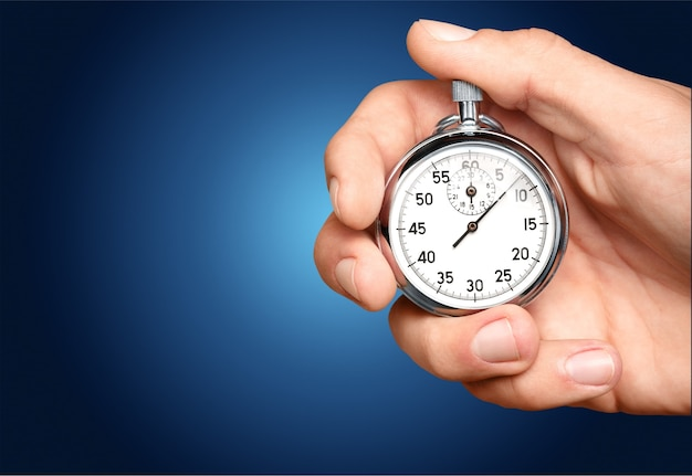 Крупным планом секундомер в руке человека, таймер