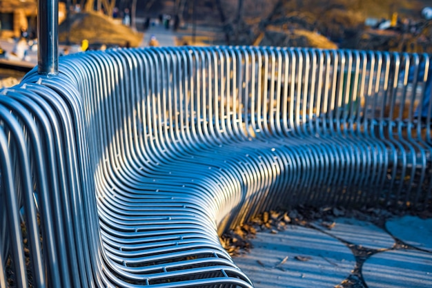 Close-up street bench metal pipes arranged parallel
