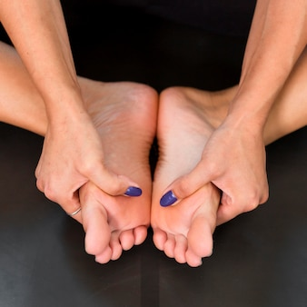 Close-up stretching feet sport at home concept