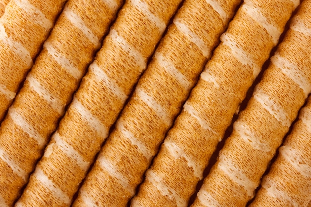 Close-up of striped wafer rolls. background or texture