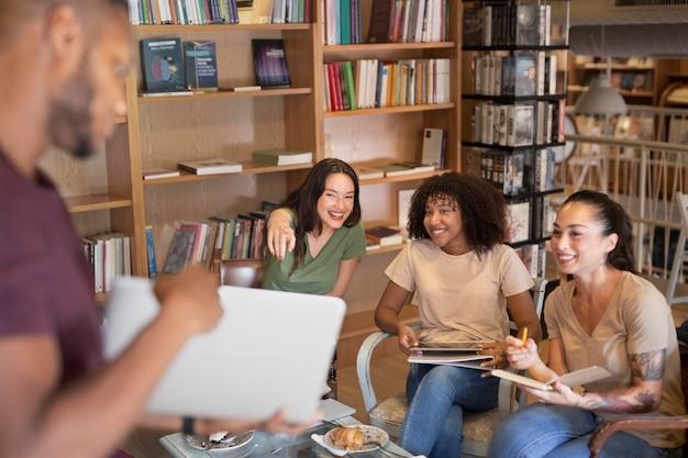 Close up students at library