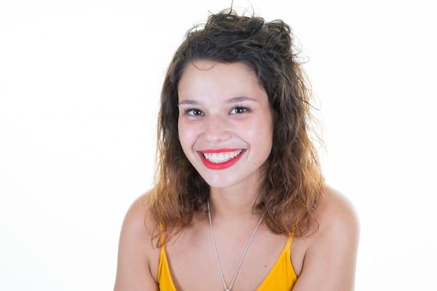 Close up studio portrait of beautiful glamour sensual woman in trendy yellow t-shirt