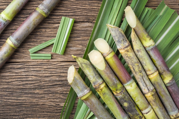 Close up sugarcane on wood background.top view