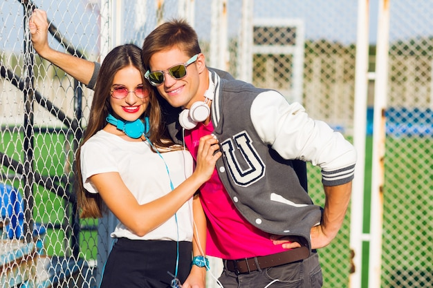 Close up summer lifestyle portrait of young fashionable couple with emotional faces