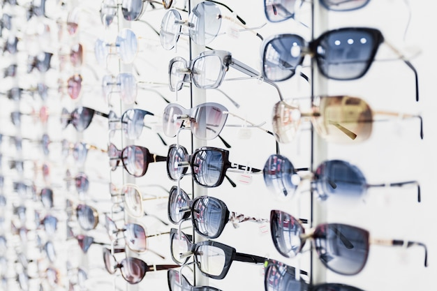 Close-up of sunglasses pairs on display