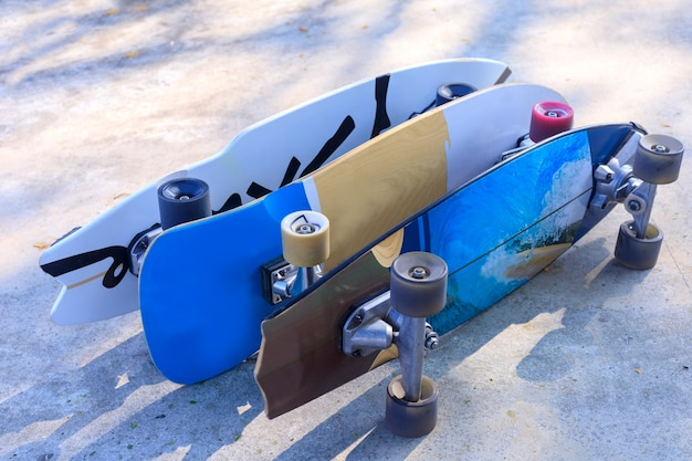 Close up surf skate board at park. lot of surfskate board on public park