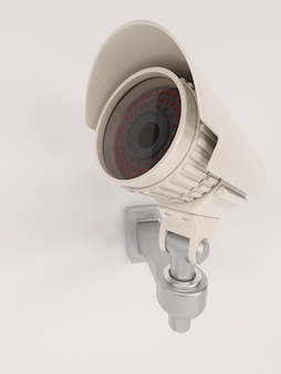 Close-up of surveillance camera on the wall