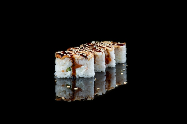 Close up of sushi roll on a black background  japanese dish