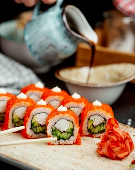 Close up of sushi rolls with crab sticks cucumber and avocado