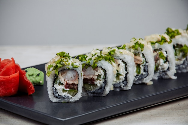 Close up of sushi rolls with shrimp, cream cheese and cucumber