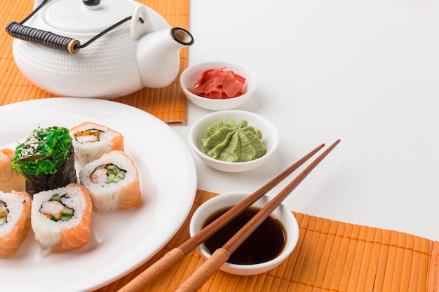 Close-up sushi rolls with soy sauce and wasabi