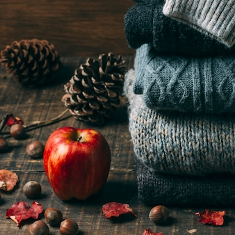 Close-up sweaters with an apple