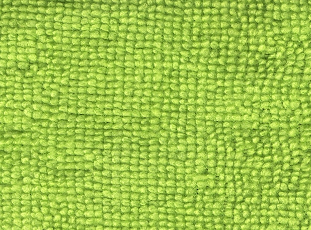 Close up of a synthetic green fabric