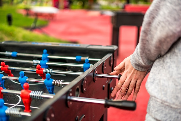 Close up table soccer foosball with defocused background. a having fun concept