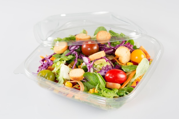 Close up of take away bowl with fast food salad