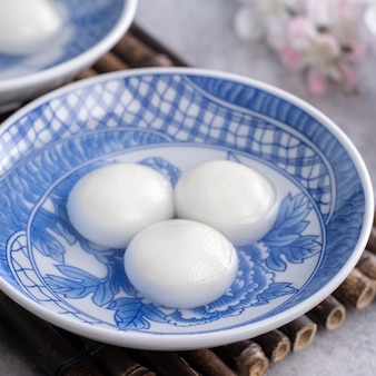 Close up of tangyuan for winter solstice festival food on gray table background.