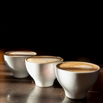Close-up tasty coffee cups with milk