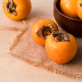 Close-up tasty persimmons on the table