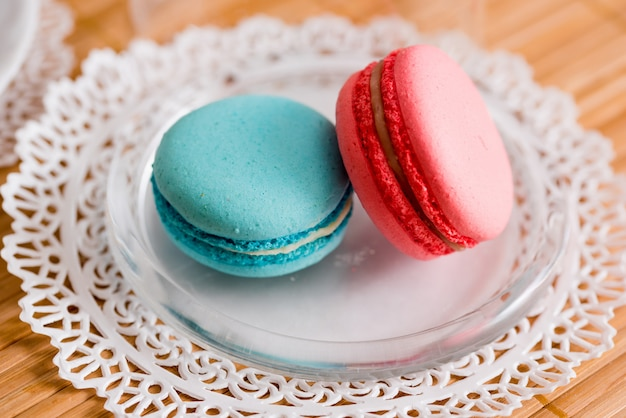 Close up of tasty pink and blue macaroon strawberry raspberry and mint flavor