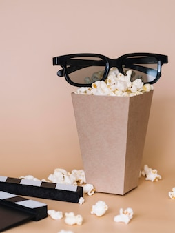 Close-up tasty popcorn snack with 3d glasses