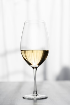 Close-up of tasty white wine glass