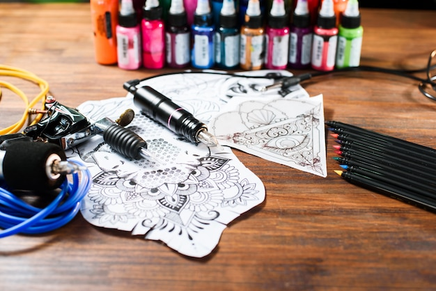 Close-up of tattoo equipment details on a wooden background