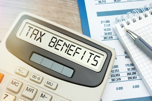 Close up on tax benefits word on calculator