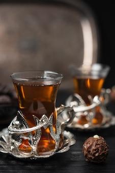 Close-up of tea glasses and truffle