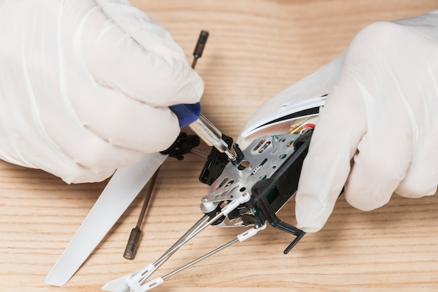 Close-up of a technician hand repairing computer parts