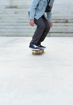 Close up teenage boy with skateboard