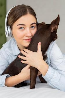 Close-up teenager hugging dog