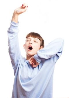 Close-up of teenager yawning