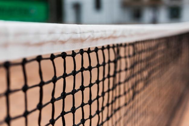 Close-up tennis net on the court